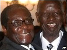 Robert Mugabe (left) and Joseph Msika (right)