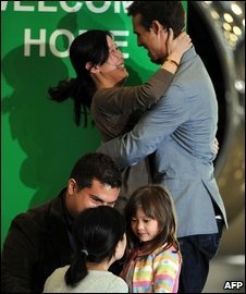 Laura Ling (top) and Euna Lee embrace their families at Burbank airport