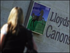 Woman walking past Lloyds office