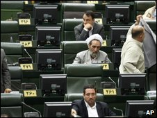 Iranian lawmakers attend an open session of parliament