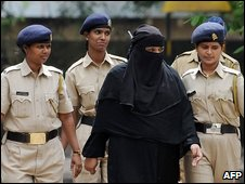 Fahmeeda Sayyed (in black) is escorted out of the Byculla Womens Jail to hear her sentence in Mumbai, 6 August