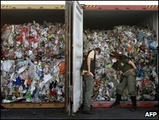 Brazilian environmental officers inspect one of the containers