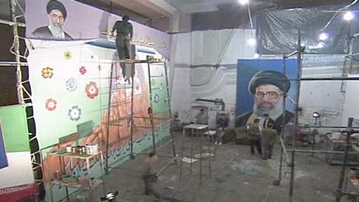 Iranian art studio with pictures of the Ayatollah being worked on