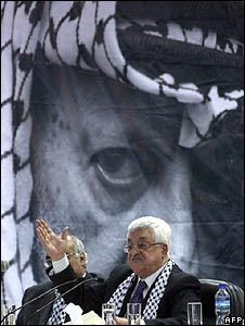 PA President Mahmoud Abbas in front of Yasser Arafat poster at Fatah conference