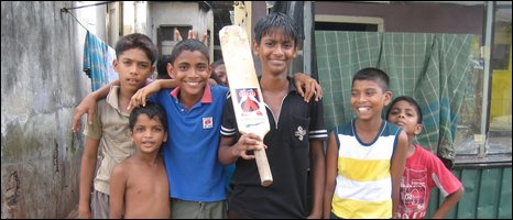 Children play cricket on the streets of Colombo