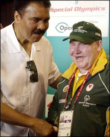 Muhammad Ali greets one of the Irish competitors at the 2003 Special Olympics