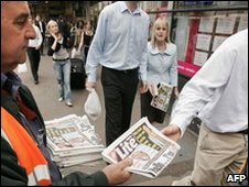 Man giving away free newspaper