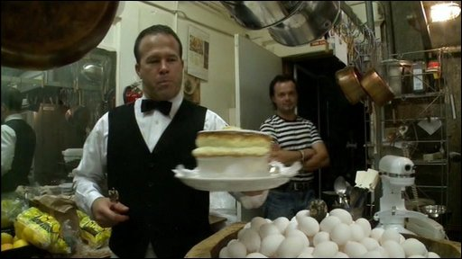 A waiter carrying a souffle at Cafe Jacqueline
