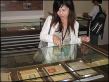 Hsieh Shyang-ling, a spokeswoman for the Taoyuan tourism department, with some of the recently revealed documents