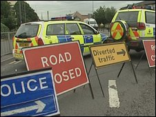 Police vehicles and signs on Gypsy Patch Lane