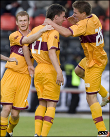Ross Forbes (centre) celebrates his strike for Motherwell