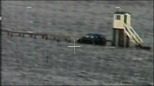 Car stranded next to shelter tower on Lindisfarne causeway