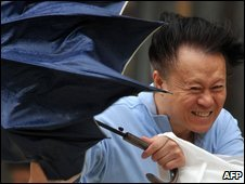 Man battles high winds and umbrella in Hsintien, Taipei county, Taiwan - 7 August 2009