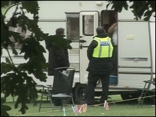 Police officer talking to one of the travellers