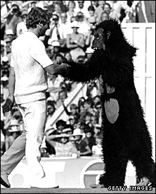 Ian Botham shakes hands with a gorilla