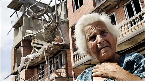 A Georgian woman in front of her destroyed apartment building in Gori