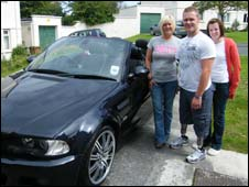Mark, his mum and Becky, with his specially-adapted car