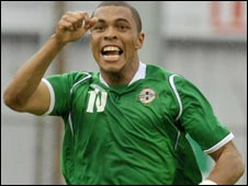 Josh Magennis celebrates after scoring in the Milk Cup final