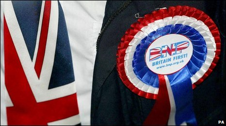 A BNP member wearing a union jack tie and a BNP rosette