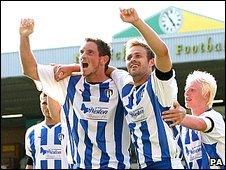 Colchester United's Clive Platt (front left) celebrates