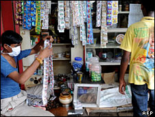 A shop owner wearing a mask in Mumbai