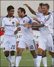 David Beckham (right) congratulates goalscorer Landon Donovan (second left)