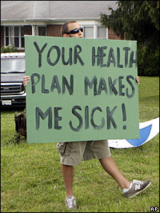 "An anti-healthcare reform protestor carries a placard saying ""Your plan makes me sick"""