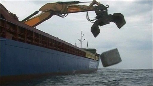 Greenpeace vessel drops granite rocks on on Swedish seabed