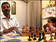 Lanka Mahesh teaches his daughter the saving habit