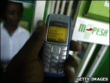 Phone showing M-Pesa money transfer
