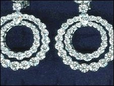 A pair of white diamond earrings that were stolen