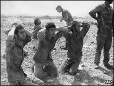 Greek Cypriot soldiers surrender to advancing Turkish troops during Turkey's invasion, August 1974 (Image released by Cyprus Press and Information Office, 10 Aug 09)