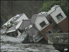 Homes collapse in raging floodwaters from Typhoon Morakot, in Kaohsiung County, southern Taiwan, on Tuesday