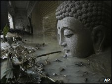 A statue of Buddha's head submerged in flood waters and debris from Typhoon Morakot in southern Taiwan on 11 August 2009