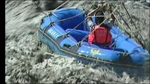 A rescuer in an inflatable boat