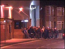 A crowd of up to 70 loyalists gathered outside Banbridge poliec station