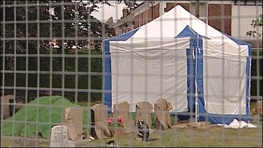 Police tent at cemetry