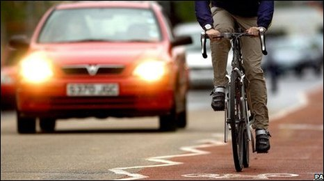 Cyclist and driver on the road