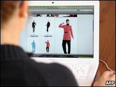 A woman looks at a website selling 'burkinis'