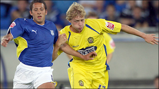 Cardiff's Michael Chopra and Dagenham's Scott Griffiths