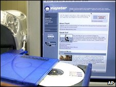 CD drive and Napster homepage (AP)
