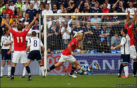 John Arne Riise wheels away after giving Norway the lead