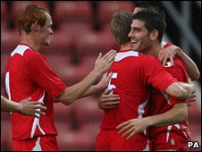 Wales congratulate Ched Evans after his first goal