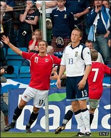 Christophe Berra is disconsolate as Morten Gamst Pedersen celebrates