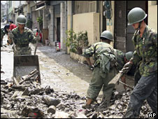 Soldiers clear mud and debris following Typhoon Morakot, 13 August 2009 -