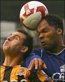 Joleon Lescott beats Richard Garcia to a header