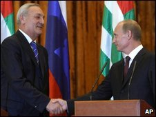 Sergei Bagapsh, left, and Vladimir Putin shake hands during their joint news conference in Sukhumi, 12 August 2009