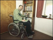 Disabled man in specially-adapted home