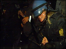 Danish policewoman moving protester, 13 August 2009