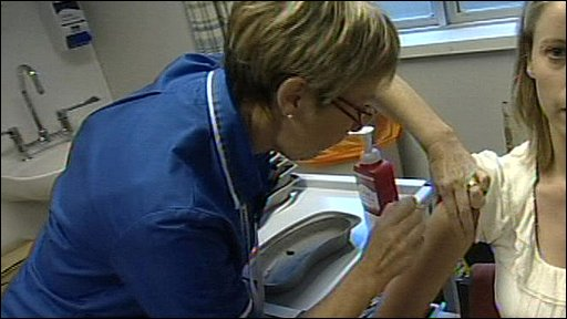 Woman being given swine flu vaccine in trial